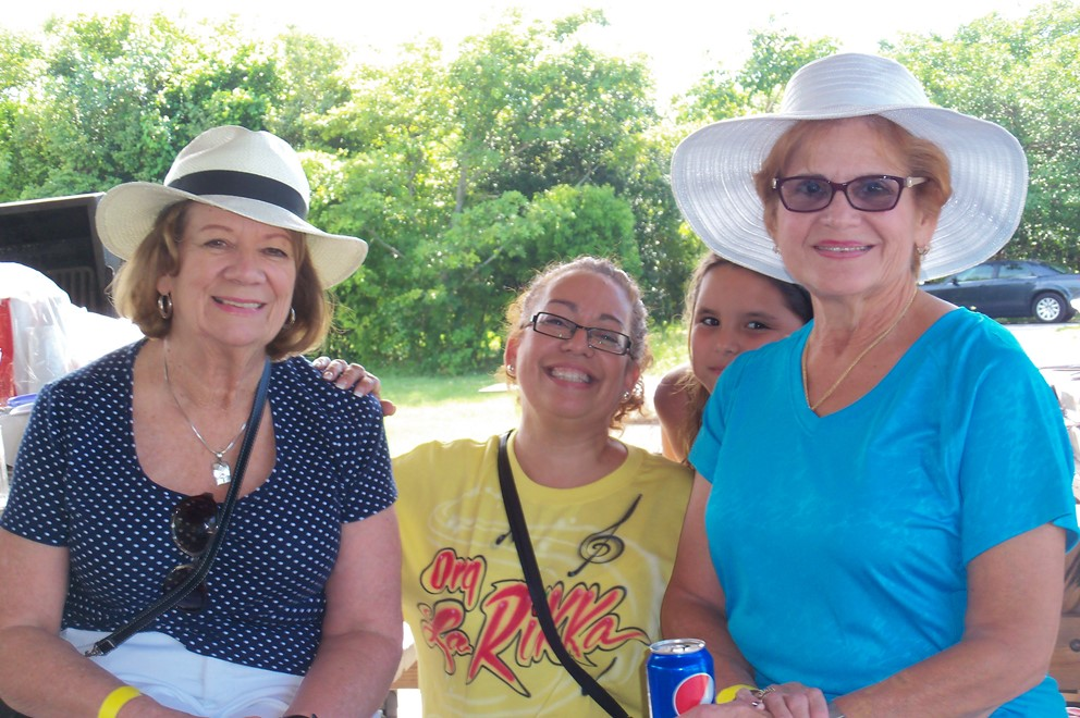 4 ladies smiling for the camera at the picnic