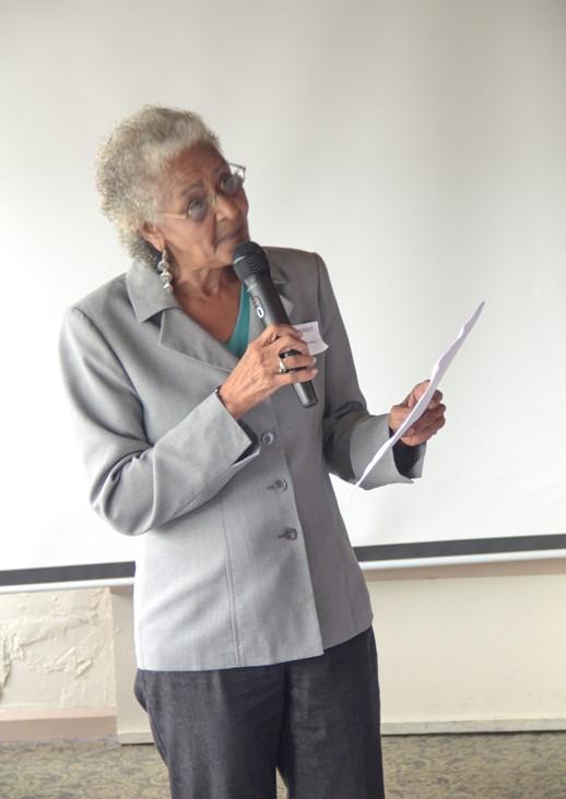 Iris Corchado, the NACOPRW Delegate giving a speech before the raffle.