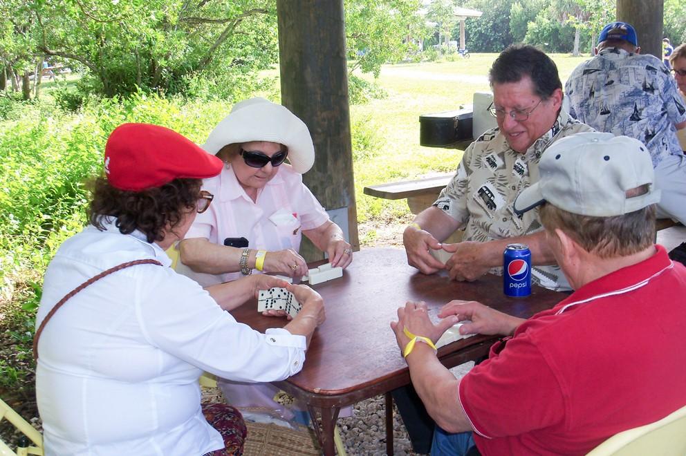 4 people playing dominoes