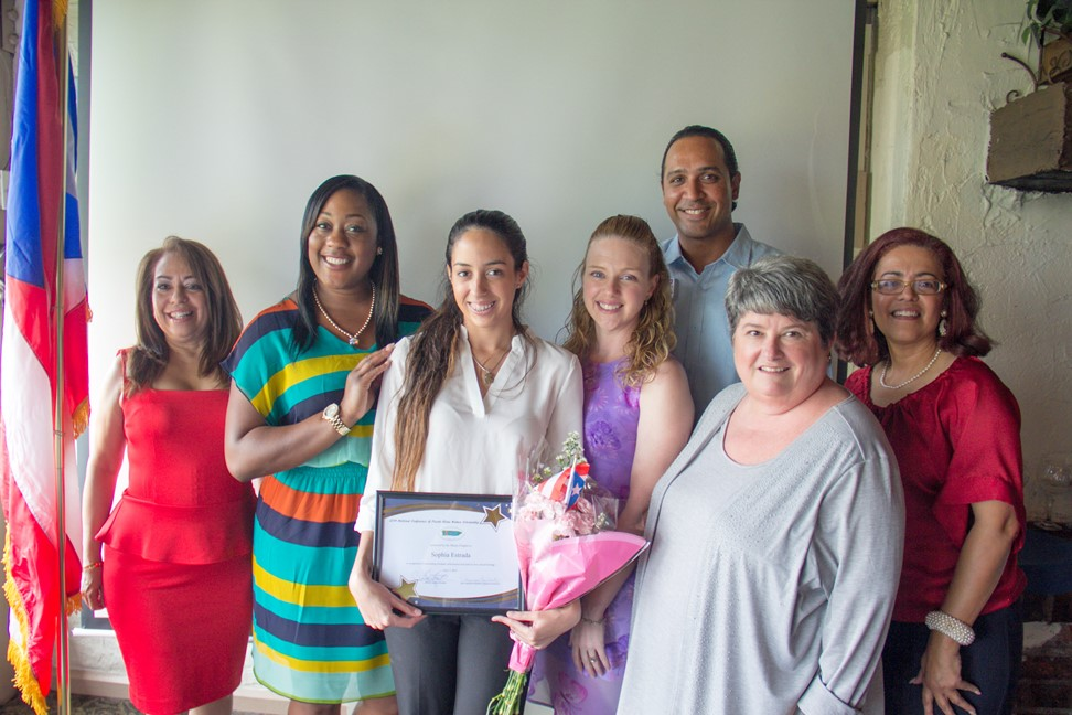 Sophia Estrada holding scholarship award with NACOPRW president Zory, Patricia Fairclough, and Maria the Scholarship Committee chairperson
